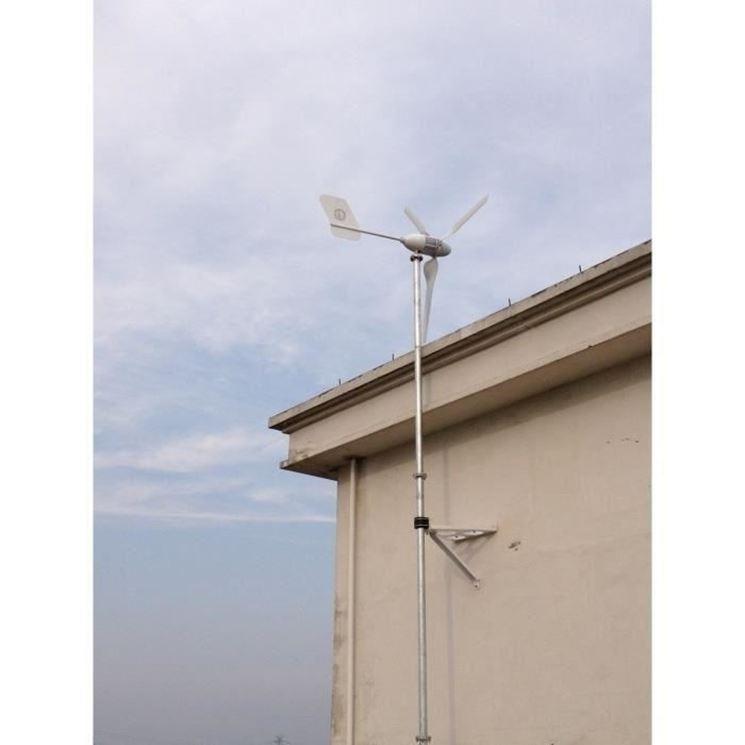 Casa con pala eolica