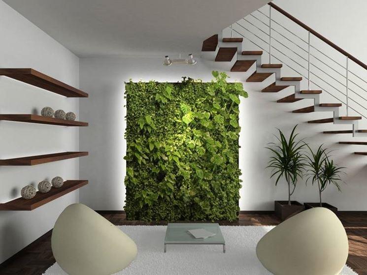 Un soggiorno adornato da una parete verde