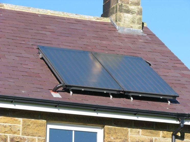 Casa che utilizza pannelli solari sottovuoto per la produzione di acqua calda sanitaria