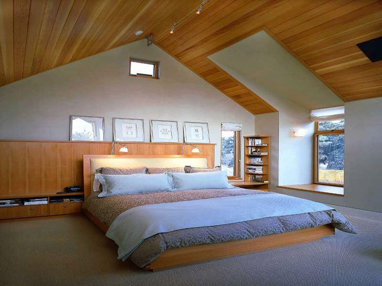 Arredare mansarde in legno costruire una casa la for Mansarda in legno bianco