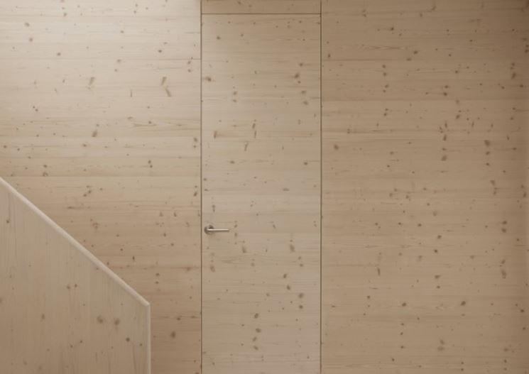Porta a filo muro in legno