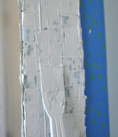 Stuccatura piastrelle mosaico