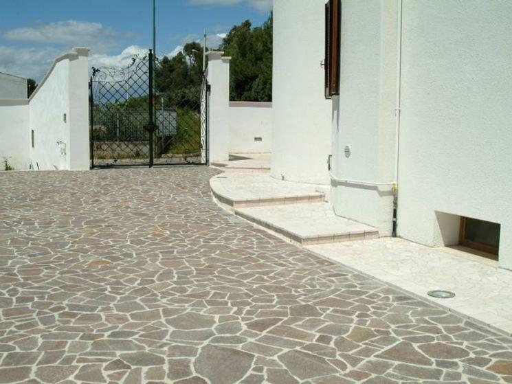 Pregi e difetti dei pavimenti in porfido pavimento da - Pavimentazione cortile esterno ...